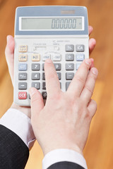 above view of calculator in accountant hands
