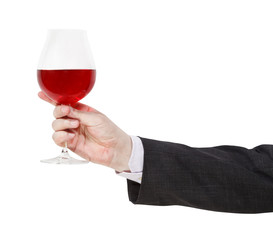 side view of red wine glass in male hand