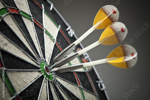Three darts in the target center - 67969822