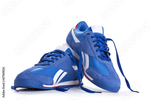 canvas print picture Blue sneaker on a white background