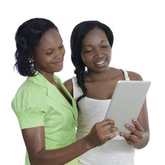 Two african women discussing with tablet PC