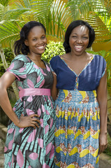 Two Happy African women Chatting Outdoor