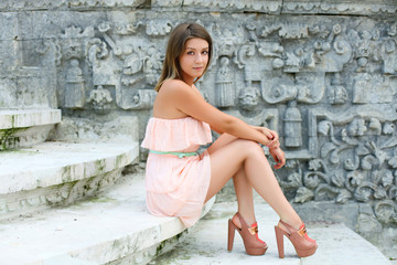 Beautiful young woman in pink dress