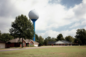 Home And Water Tank On Golf Course