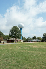 Luxury Homes On Golfcourse With Golfball Painted On Water Tank