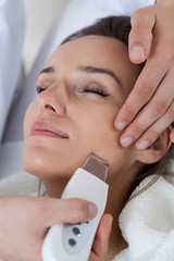 Close-up of woman having cavitation peeling