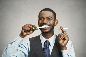 Man holding cigarette and toothbrush, smoker breath concept