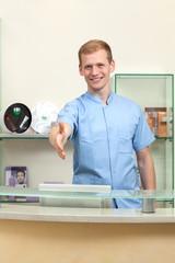 Male receptionist inviting new customer