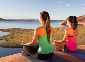 Pair of Girls Going Yoga at Lake Powell
