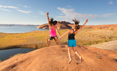 Two Overjoyed Girls Jumping