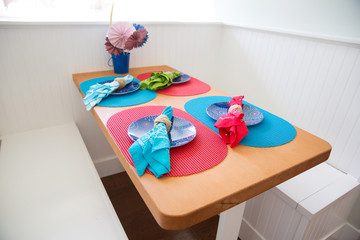 dining room table and colorful settings