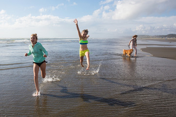 kids running and jumping at the beach