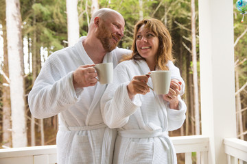 Happy couple drinking coffee in the morning