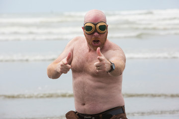 shirtless bald man