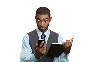 Shoked man with phone holding book, white background