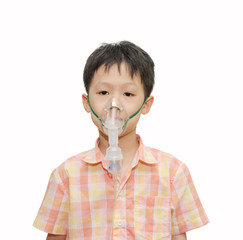little Asian boy with asthma using oxygen mask on white backgro