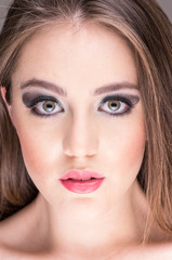 gorgeous young woman's face with makeup