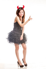 Chinese female in frilly black dress and devil horns pointing fi