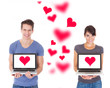 Couple Holding Laptops With Heart Shape