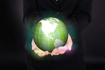 Businesswoman Holding Glowing Green Globe
