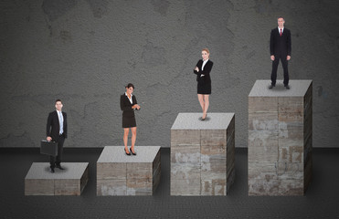 Business People Standing On Bar Graph