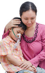 Asian mother comforts her son between using oxygen mask