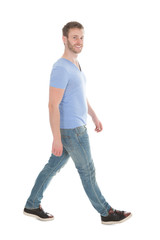 Portrait Of Man In Casuals Walking Over White Background