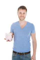 Man Holding Piggybank Over White Background