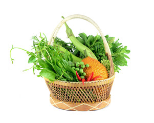 Vegetables in the basket isolated on white background.