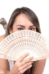 young woman holding a fan in front of her face