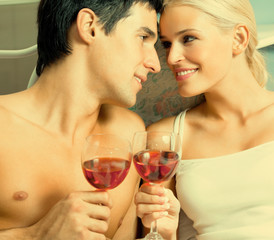 Couple with redwine at bedroom