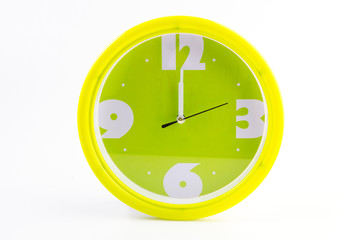 Green clock alarm isolated on white background