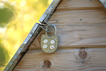 Metal well door closed on padlock