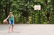 Young girl dribbling a basketball