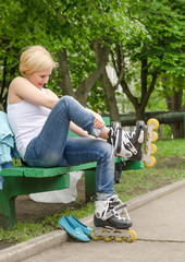 Young girl removing her rollerblades