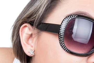 closeup of sunglasses in girl's face