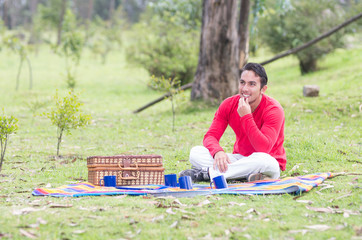 young man sitting having a picnic