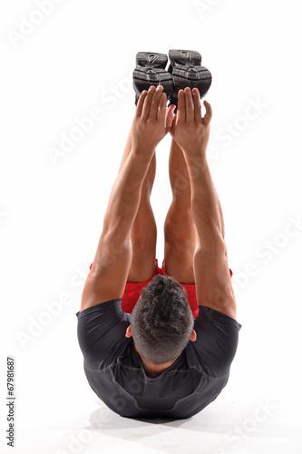 canvas print picture Hombre atleta deportista estirando músculos,calentamiento.