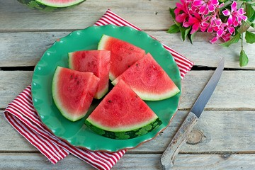 Slices of juicy watermelon on a green plate