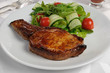 Grilled steak with vegetables on bone