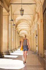 Lady walking streets of Bologna, Italy