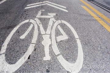 Bicycle symbol on city street