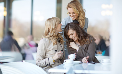 Three relaxed women at the coffee break