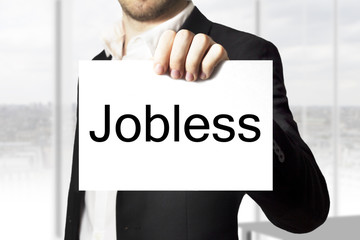 businessman holding sign jobless