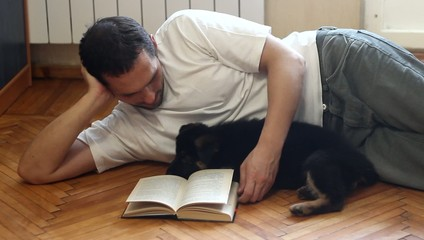 young man, book and German Shepherd puppy