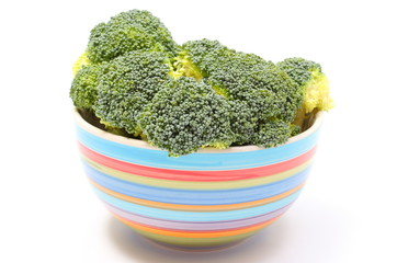 Fresh green broccoli in colorful bowl white background