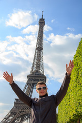 Young man hipster shows the Eiffel tower, France