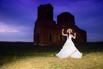 bride near an old ruined church