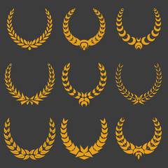 set of gold monochrome vector wreaths on dark
