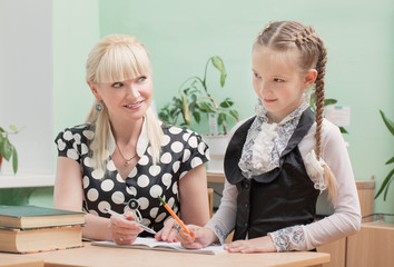 schoolgirl and teacher in classroom